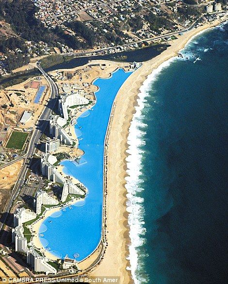 San Alfonso del Mar resort, Chile. World's largest pool which cost one billion US dollars, and holds 66m gallons, is so big you can even sail boats on it.