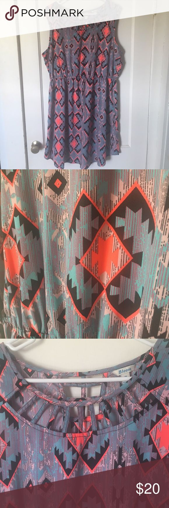 PLUS SIZE dress Aztec print plus size dress with cutouts at neckline. Elastic waist. Measurements while hanging length 38 inches. Waist unstretched 16 inches. Stretches to 24 inches. 100% polyester. bloom Dresses