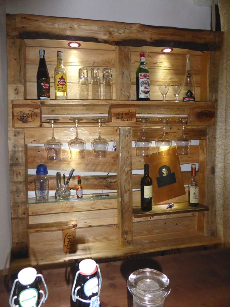 This Beautiful Lit Pallet Liquor/Stemware shelf is something that could be made for your home fairly easily, and can be adapted for many settings.