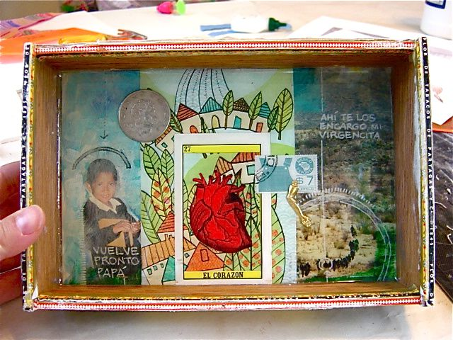 cigar box shrines for street children of oaxaca a project built by Rebecca Brooks. For a charity auction. It was eye catching to me. It seems to be representing peace.