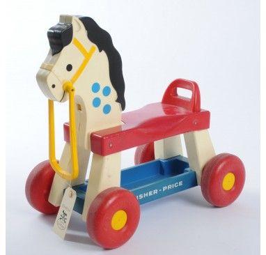 Fisher Price horse. Migue y Emi jugaron en el de su papa
