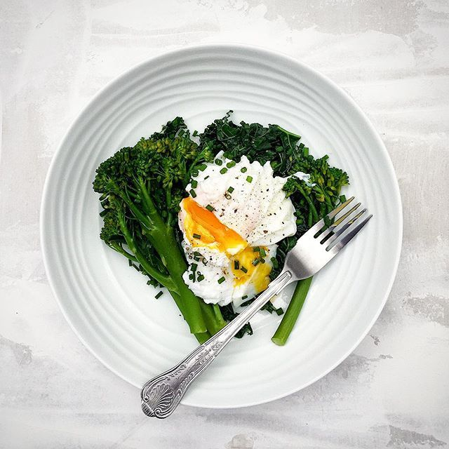 Poached Eggs On A Bed Of Broccoli And Kale With Chives
