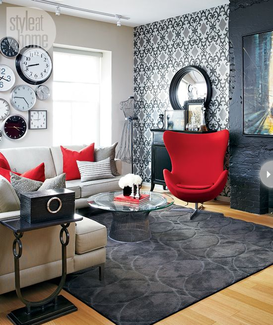 Small space with mid-century modern style coffee table and armchair are a luxurious foil to the industrial fireplace  by Jamie Alexander. (styleathome.com)