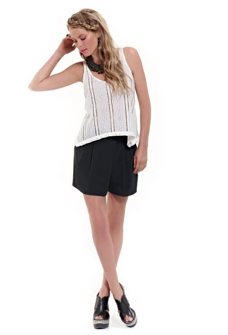 Give trends your own spin! Get ready for your next night out with a girly, perforated top and a pair of black shorts!