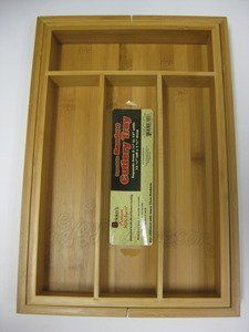 """Helens Asian Kitchen Expandable Bamboo Cutlery Tray by Harold Imports. $19.49. (3) compartments measure: 9 3/4"""" x 3 1/2"""" & (1) measures: 7 5/8"""" x 2 1/4"""".. Extending adds two additional slots each measuring: 13"""" X 2 1/4"""".. Before extending, tray measures:14""""L x 9 1/2""""W x 1 3/4""""H, with four compartments.. Bamboo Expandable Cutlery Tray This sleek tray brings order to your cluttered kitchen drawers by organizing utensils and flatware. A sliding extension on each side of..."""
