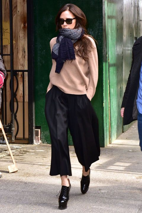 Victoria Beckham wears a cropped wide leg trouser. Shop the look, here: