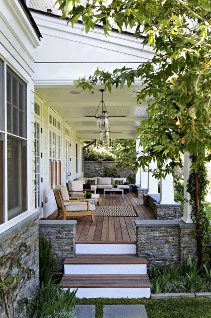 Love the low stone wall around this porch.