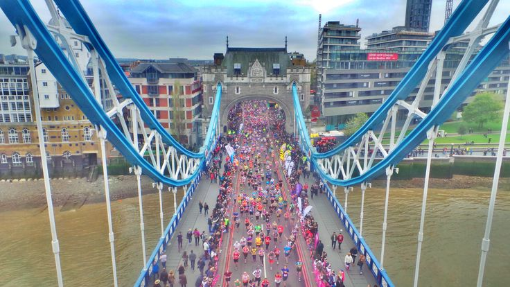 The 2015 #LondonMarathon runners crossing the iconic #TowerBridge in London