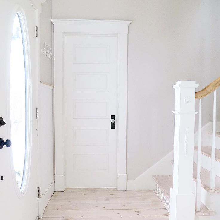 """The doors and trim are painted """"Westhighland White"""" and the wall color is """"Modern Gray"""". Both are by Sherwin Williams. You can check out the blog I posted last night for more info. on our cottage and our whitewashed pine plank floors if you're interested."""