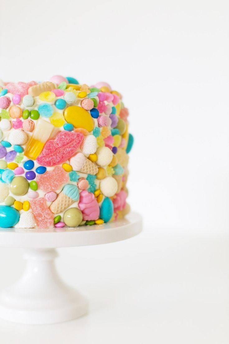Leap Year Cake -- what a fun idea! Plain sponge with coloured buttercream and then white frosting with pretty sweets and candies decorating the outside.