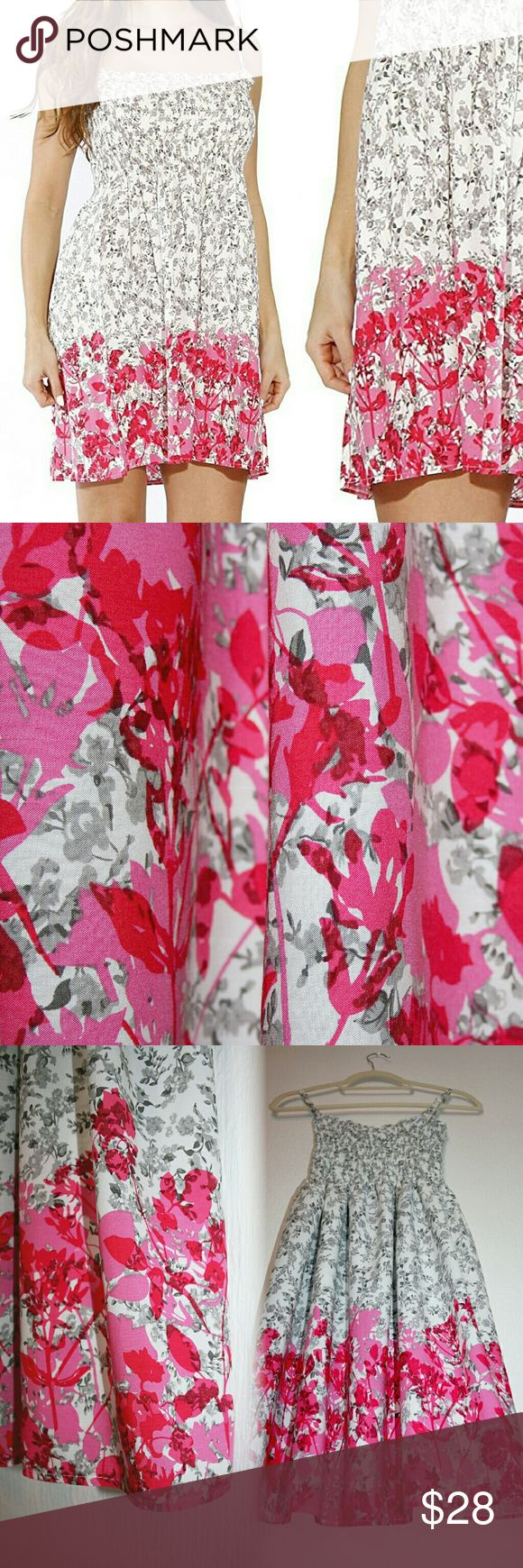 MJ,LJ Pink/White/Gray Floral Smocked Sundress NWT This comfortable, lightweight floral mini dress is cute & flirty! The bottom third of the dress features the silhouette of bright pink & magenta flowers that overlay an smaller, more detailed, allover gray & white floral pattern. It features adjustable spaghetti straps and an elastic smocked/sheared panel fitted to the bust. The soft fabric is 100% rayon challis (not see-through, but very lightweight). I'm happy to provide measurements upon…
