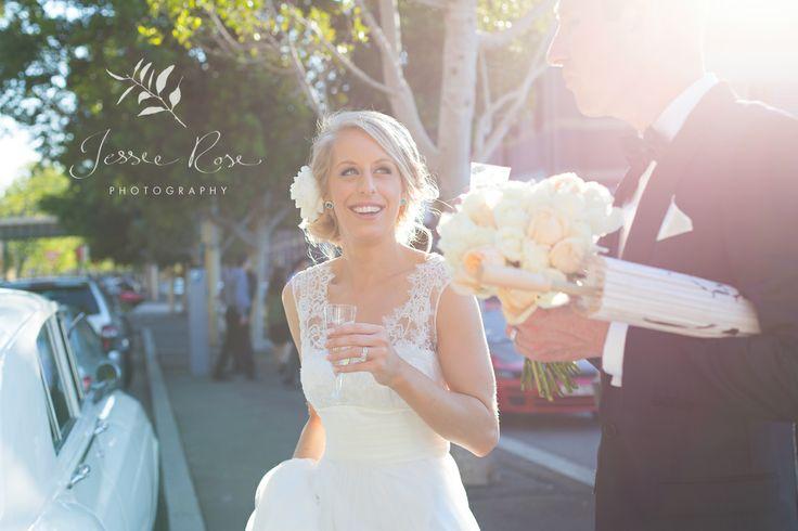 Jemimah & Christopher @ Jessie Rose Photography #sydneywedding #weddingphotography #bride #groom #champagne #love #therockssydney #magic #light #bouquet