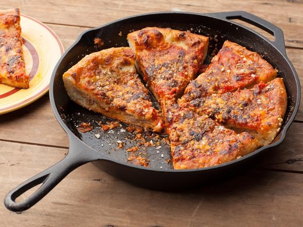 Chicago-Style Deep Dish Pizza -- With a cast-iron skillet and super-hot oven, you can mimic the crispy crust exterior of this layered deep-dish pie.