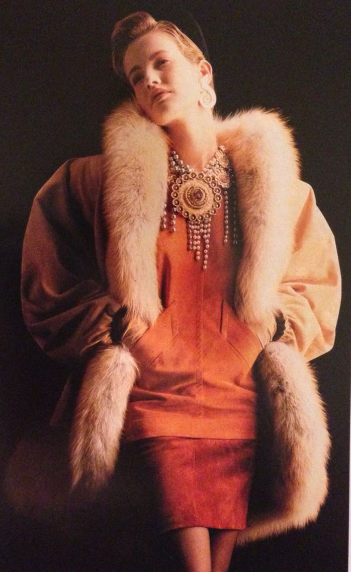 Yves Saint Laurent Haute Couture- A/W 1987-88 Suede jacket lined in Golden Island Saga fox fur. Orange suede tunic with diagonal pockets and a short matching skirt. L'Officiel No. 734- September 1987