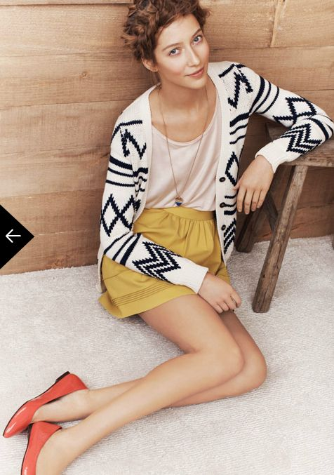 This is cute, I like the patterned cardi with bold skirt and shoes.