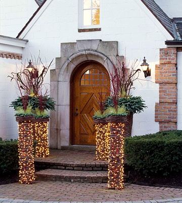 Outdoor Christmas Dècor::Light-wrapped Columns with Greenery Crowns.