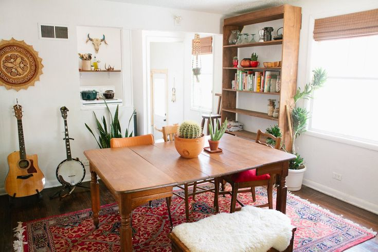 Lauren & Stiles' Southern Bohemian Homestead- love the bookshelf, rug, and bench for cozy seating.