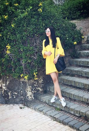 Look by @camila_sanchez_martinez with #sneakers #casual #zara #dresses #whitesneakers #bags #danielwellington #jewelry #adidassuperstar #springlook #blackbags #yellowdresses.