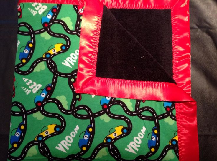 green race car with black cuddle fleece and red trim. 36x36""