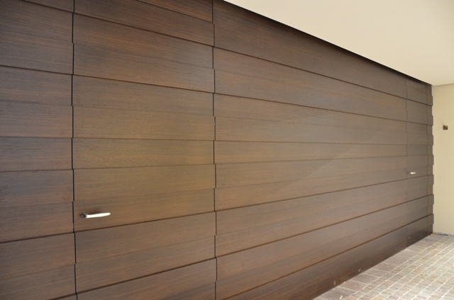 Associazione Artigiani_Trento.  Walnut staves wall, with matching flush door .