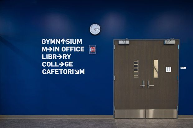 Arrows replace letters in playful wayfinding to key areas in the school.