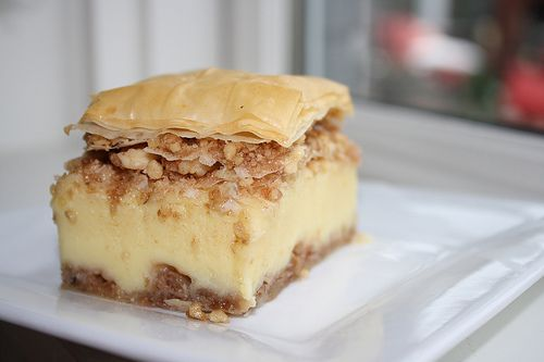 This is my husband's favorite dessert. It is a lesser known cousin of the well known favorite baklava. My husband loves it for the rich and creamy custard that is not too sweet. It is enclosed in a blanket of crispy and buttery filo and two layers of sweet and crunchy walnuts and cinnamon.