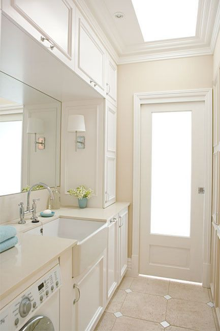 Awesome storage in laundry. Could definitely work for a combined bathroom/laundry too.