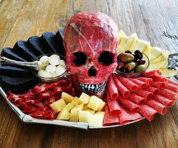 This recipe is one of my personal favorites and has been my go-to Halloween appetizer for years. Not only is it delicious, it's creepily realistic…so realistic in fact that I've used it on camera before for a CSI investigation themed film shoot. One of the actors in that shoot, a former Chicago police officer, told me that it was disturbing how much the prosciutto-wrapped skull looks like the real thing. I didn't ask for more details and he didn't elaborate. Pro...