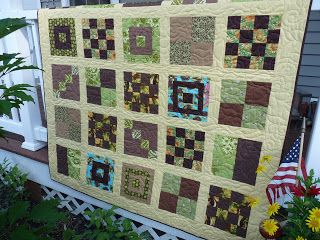 Same quilt idea but with beige sashing and borders. Just to give you an idea of a non-white design.  :)  The blocks are a little darker and use more chocolate brown because the borders were darker.