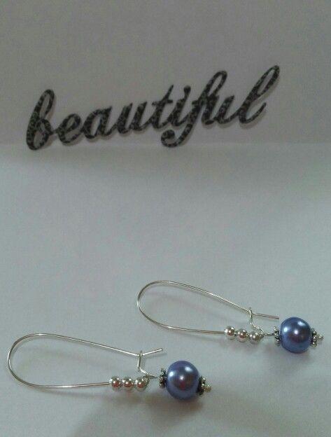 Aros con perlas. Hermoso color.