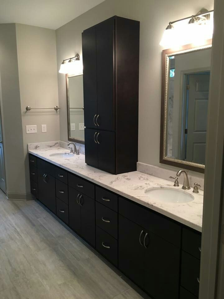 master bath is homecrest cabinets rainier door maple java stain the hardware is 53003 g10 amerock countertops not provided