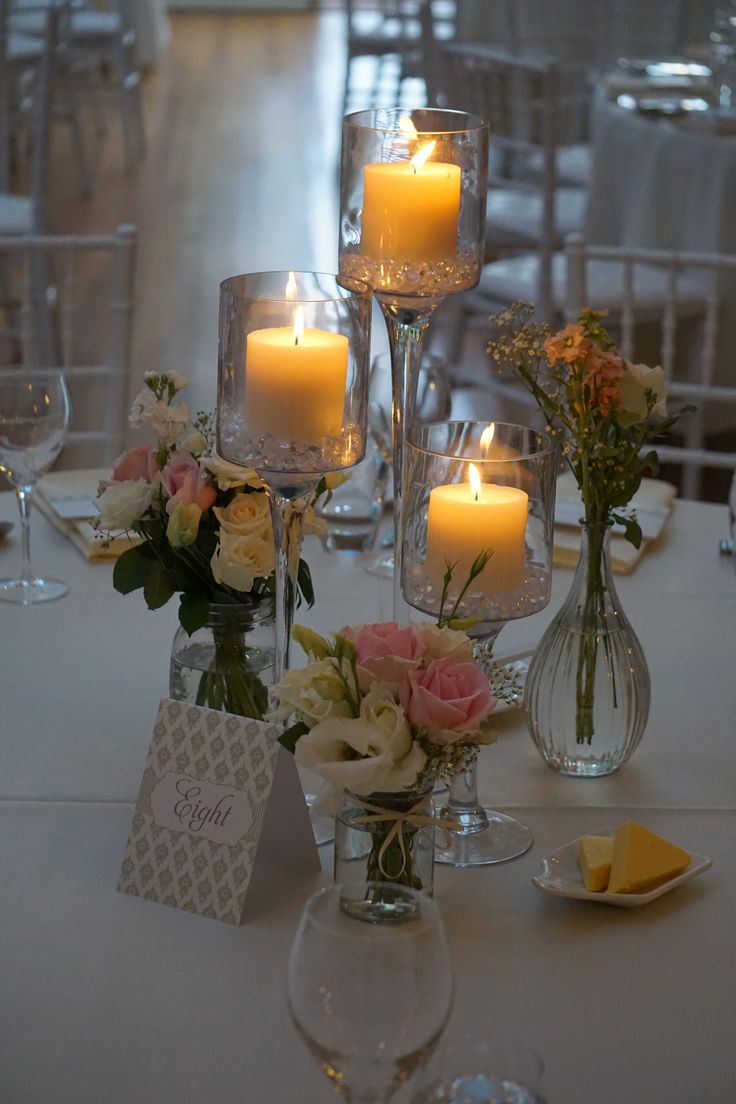 Stem Cylinder Centrepiece - with variety of bottles with fresh florals - by Toowoomba White Wedding and Event Hire, Weddings, Parties, Corporate Functions {Toowoomba, Surrounding Areas}