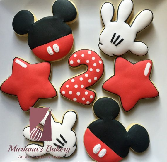 ✨✨take a look at our free shipping offer here:✨✨ https://www.etsy.com/listing/250915600/mickey-mouse-sugar-cookies-2-dozen-free  12 decorated sugar cookies made to order and decorated with royal icing. Each order is made from scratch and hand decorated. Vanilla sugar and chocolate sugar flavor options available. The vanilla sugar cookies are pictured. Please indicate which flavor when placing your order.  EACH ORDER INCLUDES: - 3 glove cookies as show - 3 body cookies as show - 3 star…