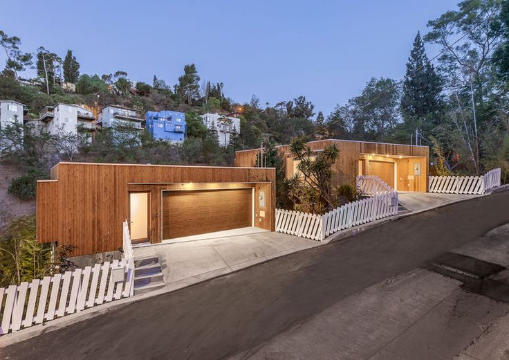 Cool update on a picket fence! Brother and Sister homes street view by Anonymous Architects