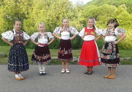Vígľaš village, Podpoľanie region, Central Slovakia.  Girl in red wears stylizated version of regional folk costume, probably from some folk ensemble.