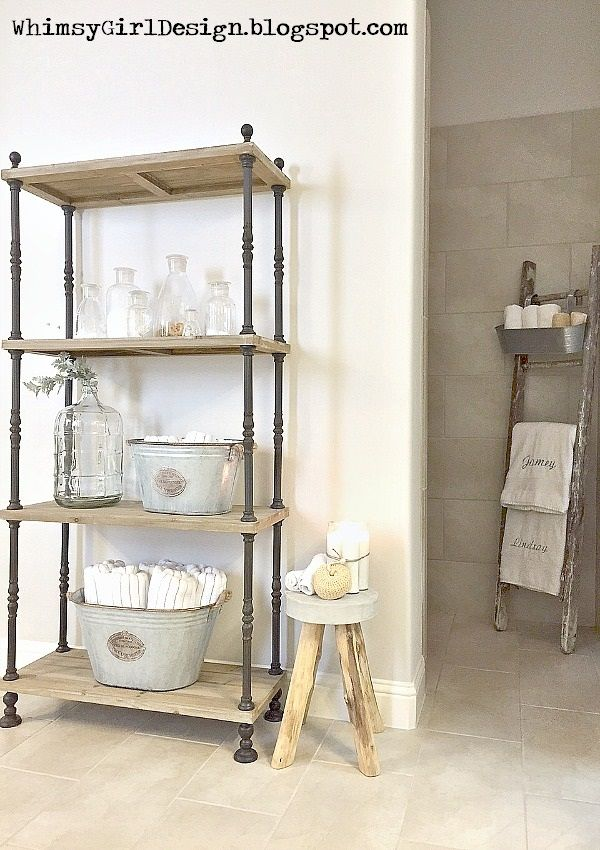 Using items like the rustic wood shelf and small stool from HomeGoods, along with a distressed wooden ladder, was a great way to add storage space for towels while creating a spa like feel in our bathroom! {Sponsored Pin}