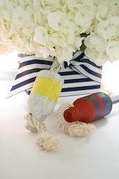 Fun nautical centerpiece design: white hydrangeas, blue & white striped wide ribbon GORGEOUS!