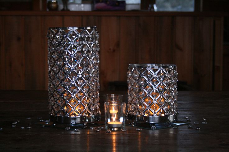Glitz and Glam....2 rhinestone candle holders...2 votive candles...2 mirrors....with jewels in between. Don't know if there's a need for flowers with thus centerpiece. I you think so, then lets put some in. Your call!  https://www.facebook.com/focalpointdesignsanddecor