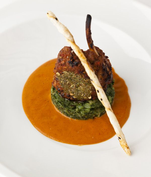 This lamb rack recipe from Vineet Bhatia adds an Indian style to a rack of lamb by giving it a spiced crust and pairing it with stir-fried spinach and potatoes.