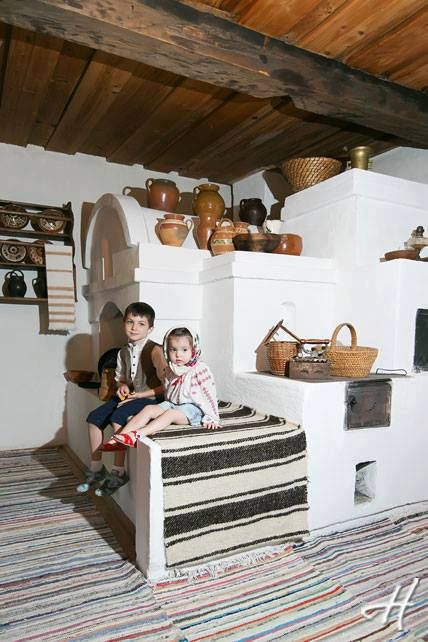 Traditional moldovan home,  wirh a huge cob stove. very similar to southwest adobe work
