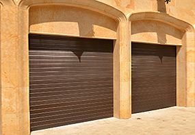 Fiberglass Garage Door Model 984   Impression Collection®   This garage door features a horizontal V-groove design with a mahogany wood grain pattern.   Learn more at overheaddoor.com