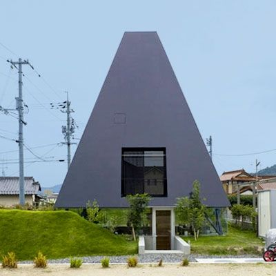 Pyramid-Shaped House  Hiroshima, Japan  This shiny, black pyramid-looking structure in Hiroshima may seem futuristic and modern, but the architects at the Suppose Design Office were actually inspired by the earliest form of Japanese architecture: pit dwellings. Japan's first pit dwelling dates back to around 200 B.C. when holes were carved into the landscape and covered by thatched roofs.