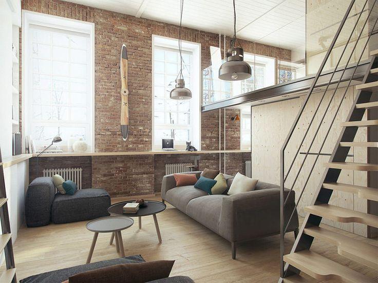 A decoração segue a linha rústico industrial, com destaque para os tijolinhos e alguns fios à mostra. A configuração padrão do ambiente principal é de sala de estar com um confortável sofá e puffs. - limaonagua