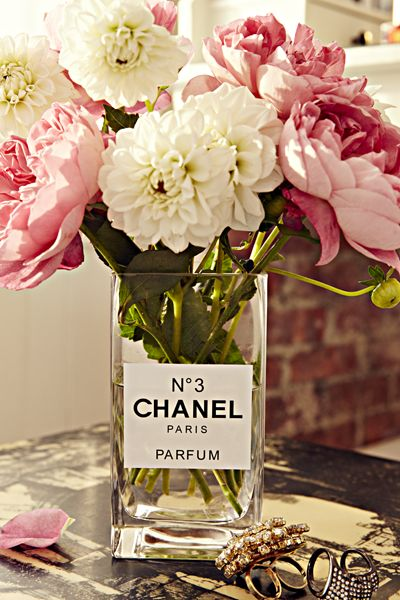 A snoozy vase gets an elegant makeover when you print out a sticker that makes it look like a perfume bottle. Can't make stickers in your printer? Draw a label on a piece of heavy paper and use glass glue.: