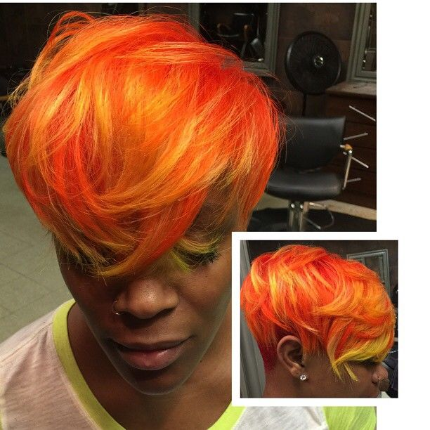 """Full weave this was created with matrix color graphics lacquer . Matrix has a permanent line of red, yellow, blue and orange. We created this color on white blonde weave. Matrix orange 3"""" down 2"""" of the yellow and the remaining orange on the ends. We call it FIRE BALL. All my fellow stylist need to check out matrix color graphics lacquer to make permanent vibrant colors #teddijennings #easleydone #hairstylist #razorcut #matrix #shorthair #color"""