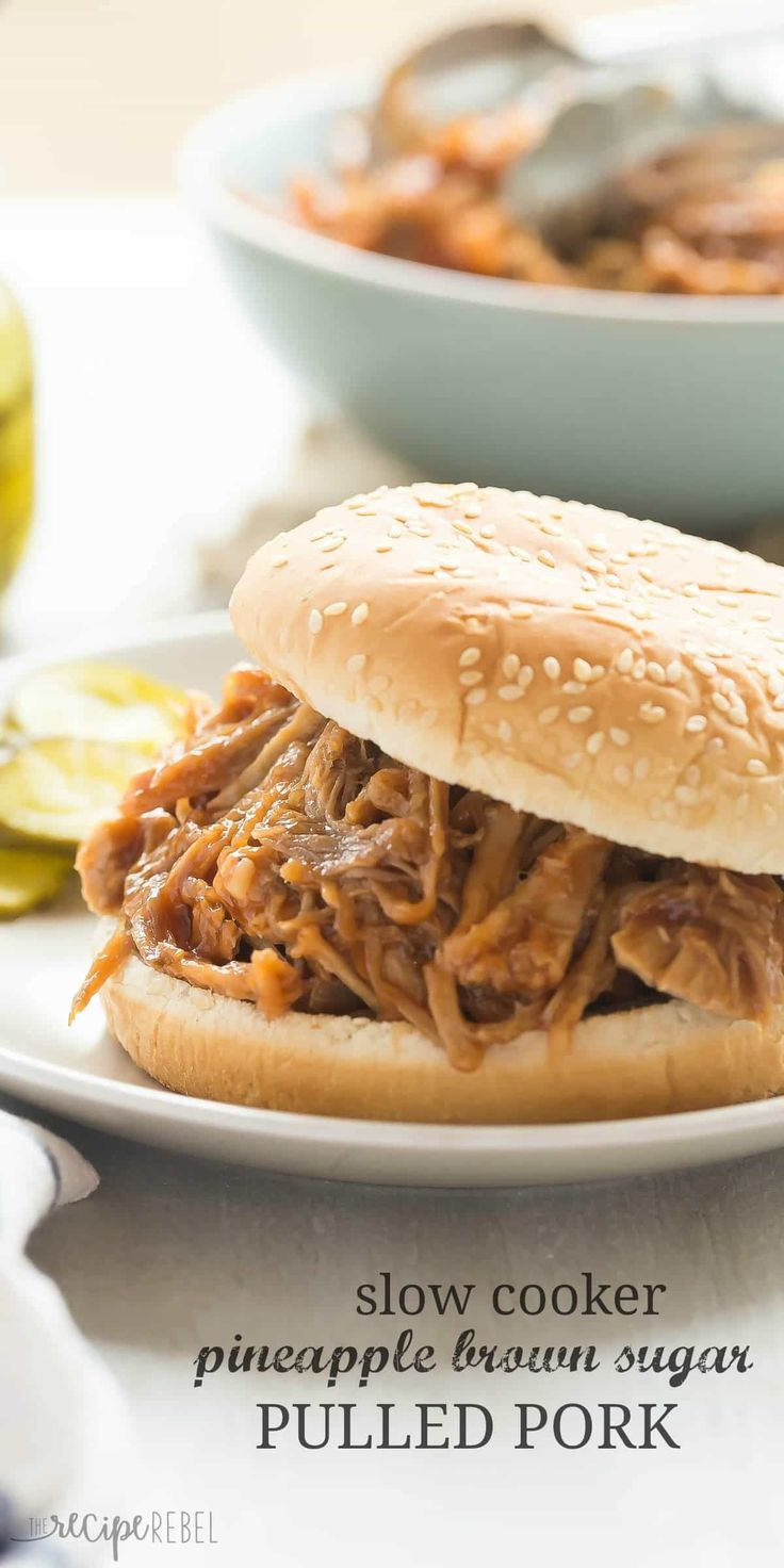 This easy Slow Cooker Pineapple Brown Sugar Pulled Pork recipe is smothered in homemade pineapple brown sugar barbecue sauce! Sweet, tangy and so tender! #pulledporkrecipehomemade