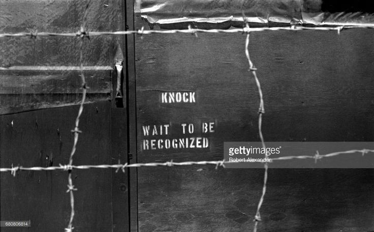 A notice painted on a building at Da Nang Air Base in South Vietnam in 1970 during the Vietnam war advises military personnel to knock and wait to be recognized before entering. The military base was a Republic of Vietnam Air Force facility which the United States military used as a major base during the Vietnam war. The U.S. stationed Army, Air Force, Navy and Marine Corps units there during the war.