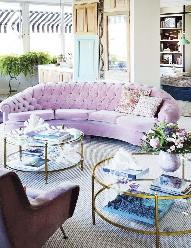 Tour a Sophisticated and Chic Spanish Home// pink tufted sofa, stripe awning, round coffee table, coffee table styling