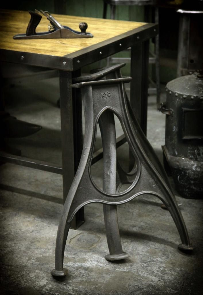 "These table legs are made of cast iron and forged in a foundry in Richmond, VA. The foundry mold was developed by the Carbon Team and was inspired by heavy machinery legs from old factories. We ship these legs using freight so please call for an estimate. (Dimensions: 28"" Tall and 26"" Wide at Base, Weight: 100lbs)"
