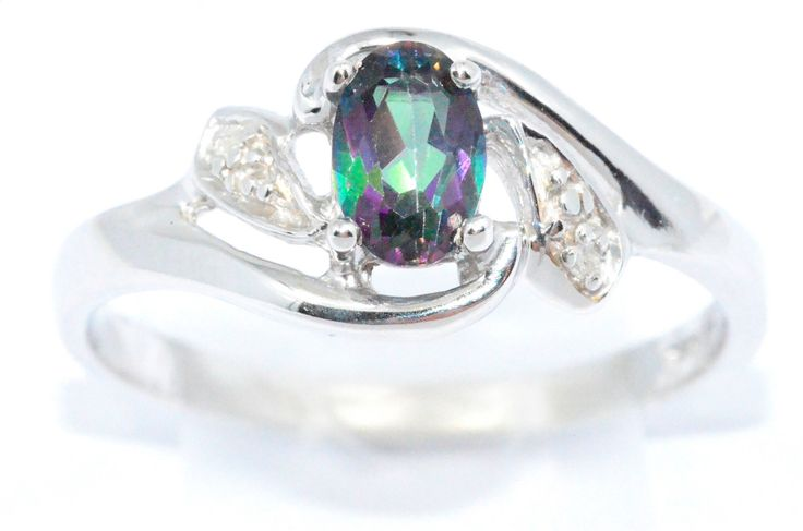0.50 Ct Natural Mystic Topaz & Diamond Oval Ring Sterling Silver Rhodium Finish by ElizabethJewelryInc on Etsy https://www.etsy.com/listing/157974960/050-ct-natural-mystic-topaz-diamond-oval